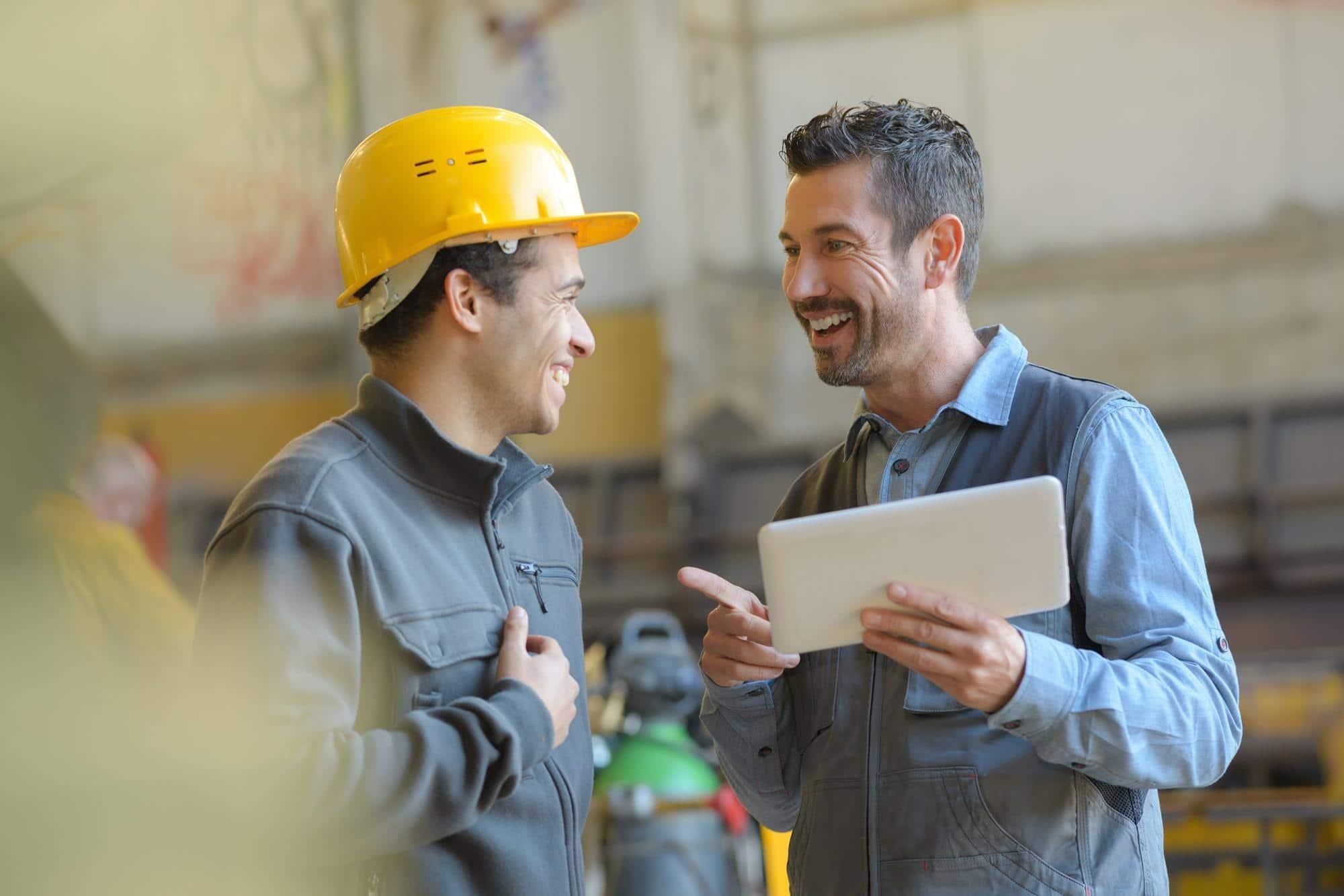stock-photo-workers-talking-and-laughing-at-a-factory-648243124-550482-edited.jpg